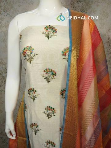 Cream Silk Cotton unstitched Salwar material(requires lining) with embroidery work on front side, Plain back side, orange silk cotton bottom, silk cotton dupatta with tassels.