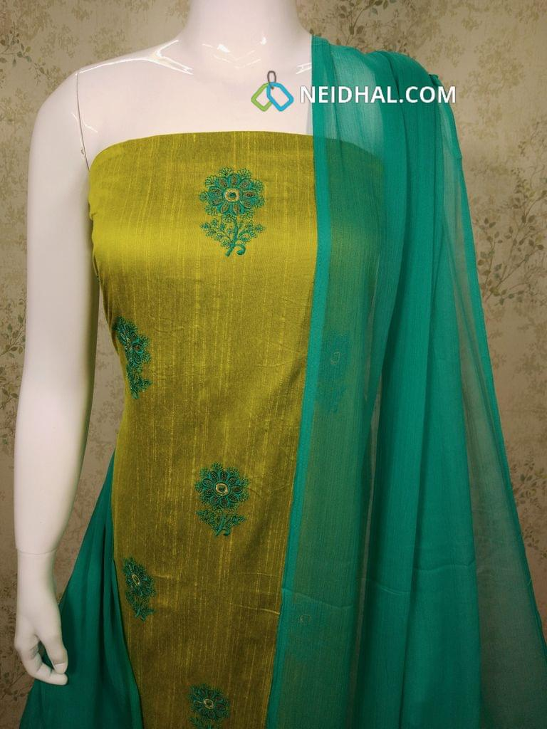 Green Silk Cotton Unstitched salwar material with sequence work and thread work on front side, green cotton bottom, orange chiffon dupatta with tapings.