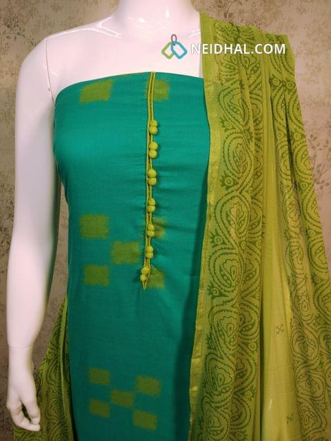 Printed Blue Satin Cotton  unstitched salwar material with potli buttons on yoke, green cotton bottom, printed green chiffon dupatta with tapings.