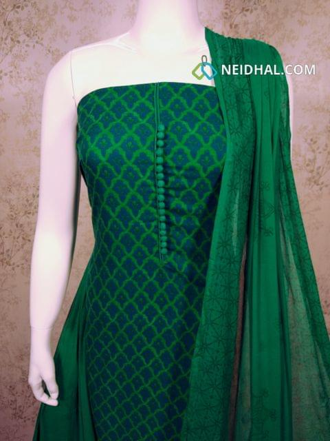 Printed Green Satin Cotton Unstitched salwar material with potli buttons on yoke, green cotton bottom, printed green chiffon dupatta with tapings.