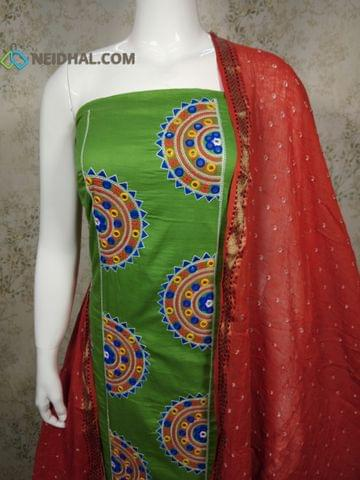 Light Green Cotton unstitched Salwar material with embrodiery and foil mirror work on panel, plain back side, orange cotton tie and dye bandhini bottom, orange cotton tie and dye bandhini dupatta with resham border.(requires tapings)
