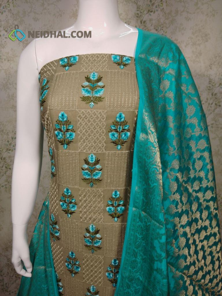 Designer Beige Silk Cotton Unstitched(Thin Fabric requires lining) salwar material with heavy embroidery work on front side, plain back side, Blue silk cotton bottom, Benaras weaving Silk Cotton dupatta with tapings.