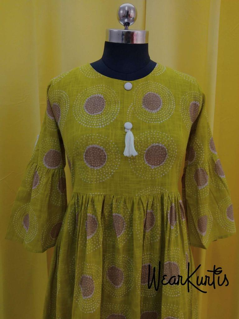 Printed Mehandhi Green Slub Cotton gathered waistline flared Kurti, buttons and tassels on yoke.(Refer Size chart, 3rd pic before ordering, No Refund, No Return, No exchange, No cancellation), Round Neck, Height 44, 3/4 Bell sleeves.