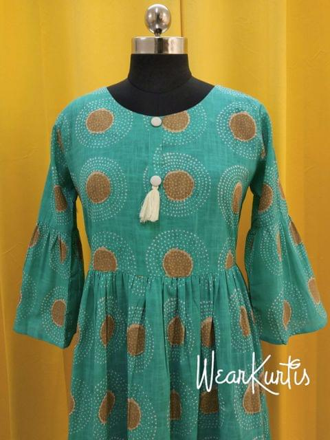Printed Blue Slub Cotton gathered waistline flared Kurti, buttons on tassels on yoke,(Refer Size chart, 3rd pic before ordering, No Refund, No Return, No exchange, No cancellation), Round Neck, Height 44, 3/4 Bell sleeves.
