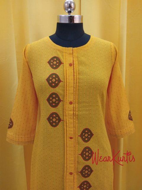 Printed Yellow Cotton Kurti with front closed placket (Refer Size chart, 3rd pic before ordering, No Refund, No Return, No exchange, No cancellation),Round Neck, Height -47, 3/4 Sleeves, front and side slits.