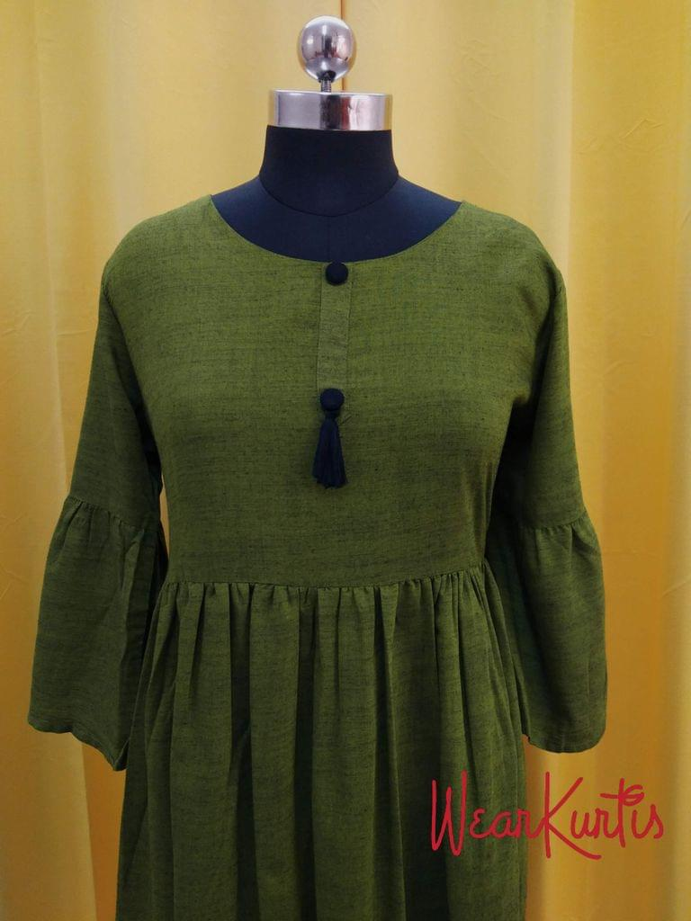 Green Slub Modal gathered waistline flared Kurti, buttons and tassels on yoke (Refer Size chart, 3rd pic before ordering, No Refund, No Return, No exchange, No cancellation), Round Neck, Height 44, 3/4 Bell sleeves.