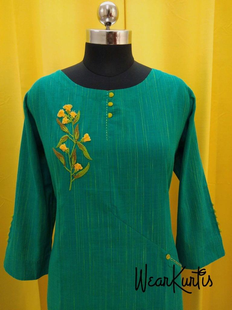 Turquoise Green Slub cotton kurti with embroidery and potli buttons on yoke,(Refer Size chart, 2nd pic before ordering, No Refund, No Return, No exchange, No cancellation), Round Neck, Height -45, 3/4 Sleeves with potli buttons, side slits, one front pocket.