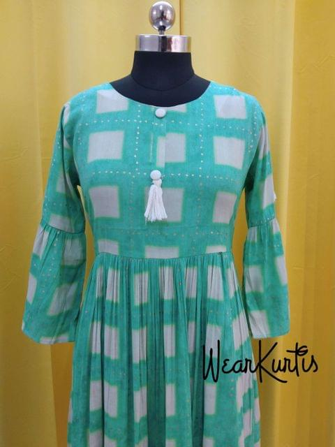 Printed Blue Checked Modal fabric gathred flared kurti with buttons and tassels on yoke (Refer Size chart, 2nd pic before ordering, No Refund, No Return, No exchange, No cancellation), Round Neck, Height 45, 3/4 Bell sleeves.