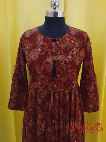 Printed Maroonish Red Modal fabric gathered waistline flared Kurti, buttons and tassels on yoke (Refer Size chart, 3rd pic before ordering, No Refund, No Return, No exchange, No cancellation), Round Neck, Height 45,3/4  Bell sleeves