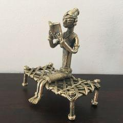 Dhokra - Tribal Woman Reading Book On Charpai