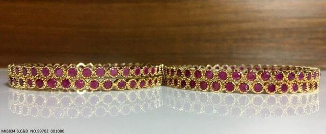 Beautiful set of 4 Bangles with an year warranty- Studded with Semi Precious Ruby Stones