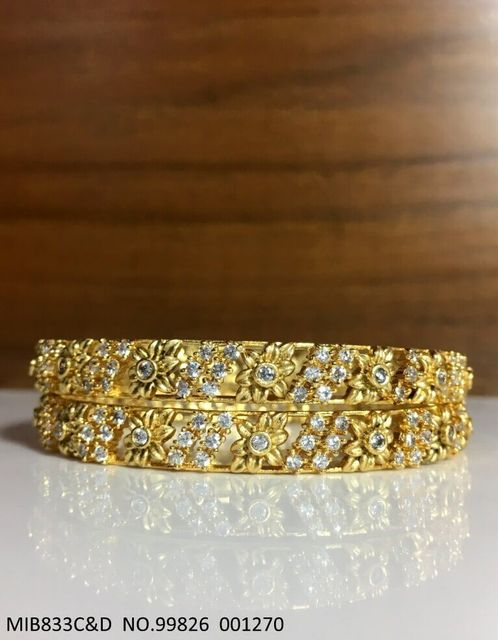 Beautiful set of 2 Bangles with an year warranty