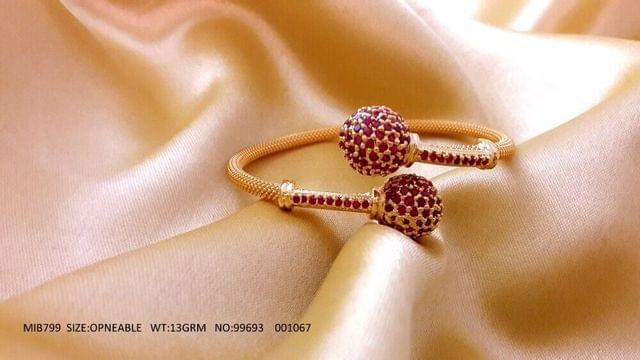 Gold plated kada with precious stone
