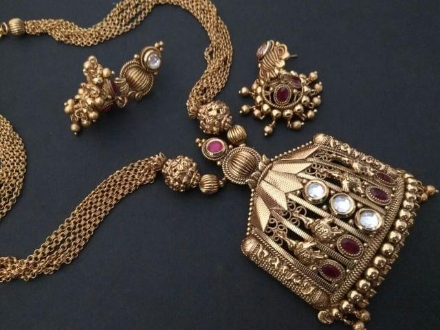 Gold Plated Necklace set with an year warranty- Studded with semi precious stone