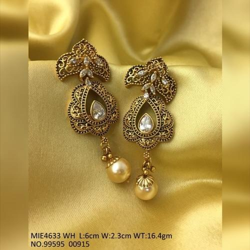 White Coloured Gold Plated Brass earring with Kundan and Pearl Stones .