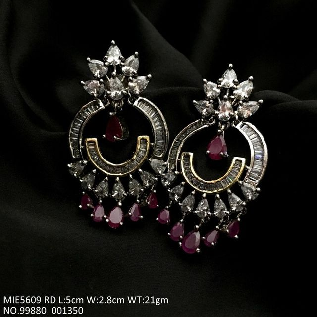 American Diamond earrings with an year warranty - Length is 5.0 cms , width is 2.8 cms, and weight is 21.0 grams