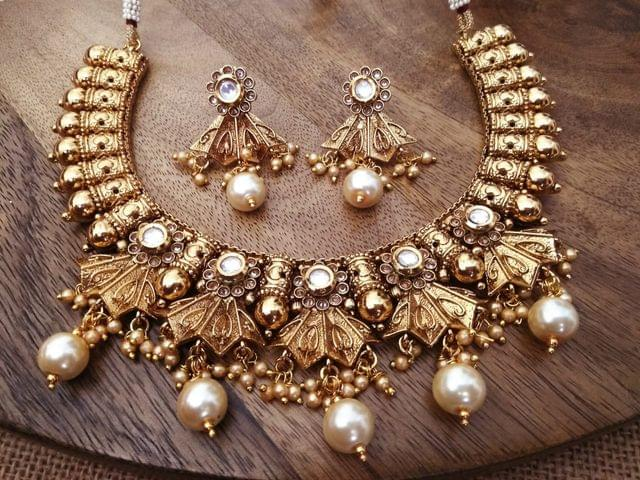 gold plated necklace set studded with Kundan Stones and American Diamond Stones and Fresh Water pearls