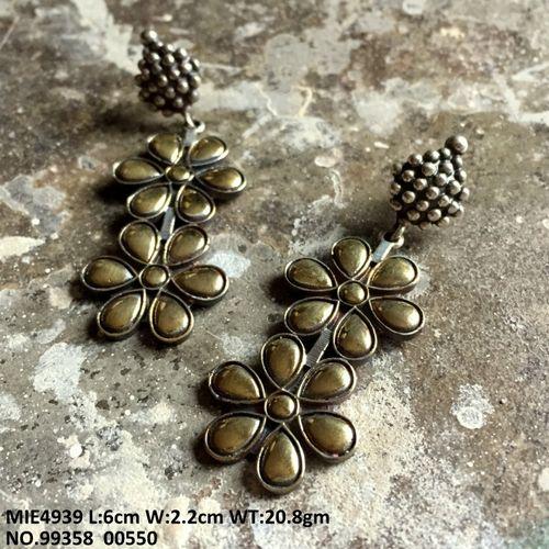 Brass earring with an year warranty