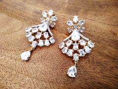Pair of beautiful American Diamond earrings with an year warranty