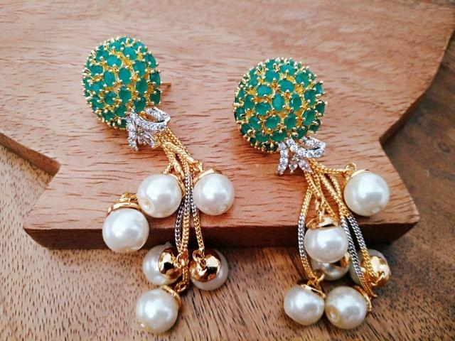 Pair of beautiful silver plated American Diamond earrings with pearls. an year warranty