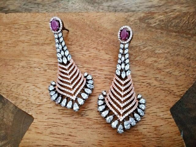 Buy this beautiful pair of  silver plated American Diamond earrings with an year warranty