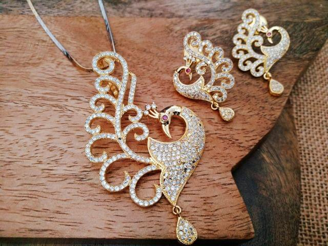 Peacock Designed American Diamond Pendant Set with an year warranty