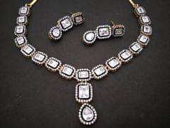 Buy this Beautifully designed American Diamond Necklace set coupled with beautiful pair of earrings .
