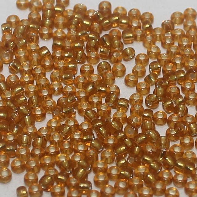 100 Gm. Nippon Seed Beads Topaz Silver Line, Size 11/0