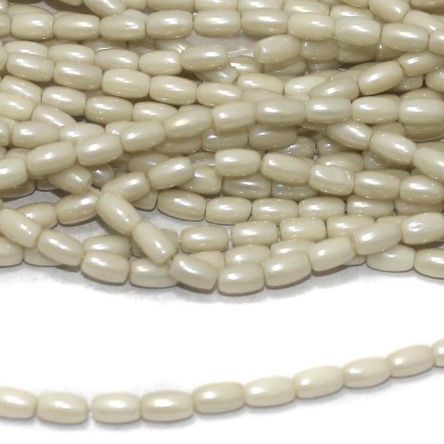 Off white luster glass oval beads 7x4mm 12 Strings